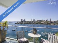 PRICE GUIDE $950k+ Luxurious harbourside haven with rare dual aspect harbour views.