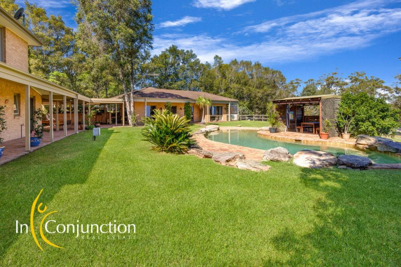 Beautifully presented home on quality lifestyle acres with extensive garaging, resort-style pool plus independent rumpus/entertainment.