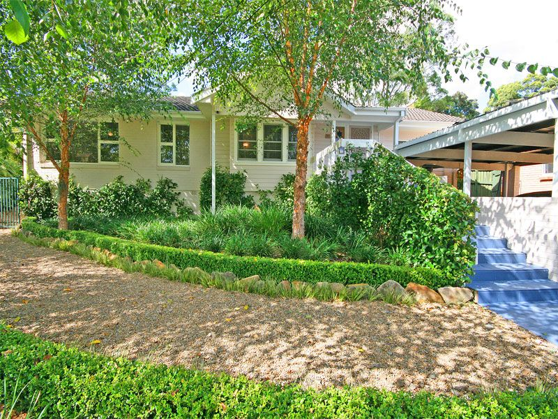 OPEN HOME CANCELLED  Picturesque cottage style country home with exquisite landscaped gardens of box hedges, native grasses and gravel pathways.