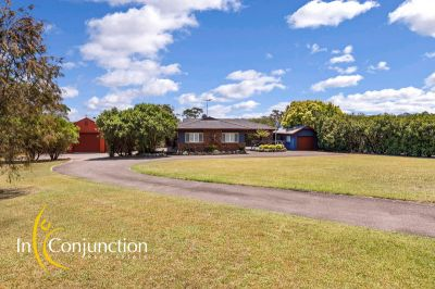 beautifully presented single level home on lovely acres with stunning vistas, large shed and pool.