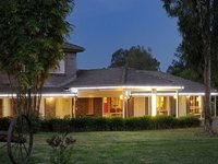 MOTEL FOR SALE- COLONIAL STYLE ON LARGE 4 ACRES