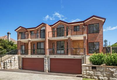 Centrally located, luxurious full brick Duplex