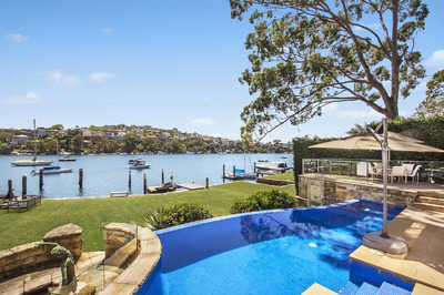 An expansive and opulent waterfront masterwork