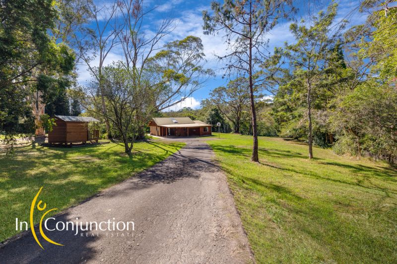 Smaller acreage with privately positioned single level home in one of Middle Dural's most premier locations.