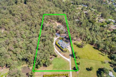 Private Acreage with Up Market Dual Living in Bonogin Valley