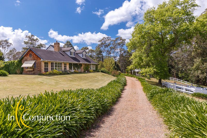 Picturesque country retreat privately positioned on beautiful rolling acres with stunning gardens and pretty dam.
