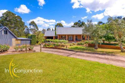 elevated setting on a magical 5 acre block with spacious home, picturesque barn and horse paddocks.