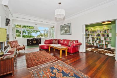 Spacious Family Home Combines Beach-House Vibes With Coastal Views & Desirable Village Location