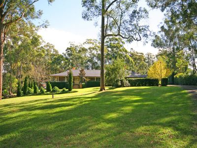 stylish family home with resort style pool and grounds in an exclusive dural location.