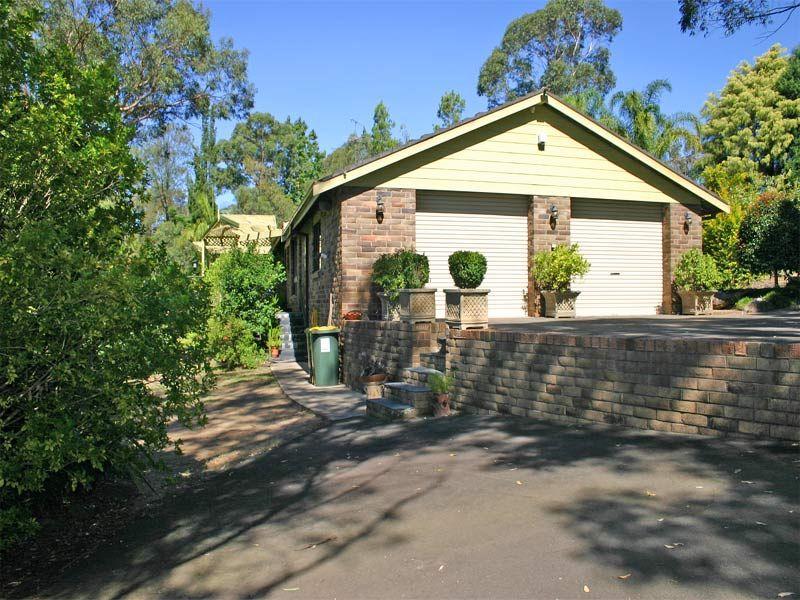 Gorgeous private retreat like setting, 5 acre property with delightful gardens, views, sparkling in ground pool lovely family home