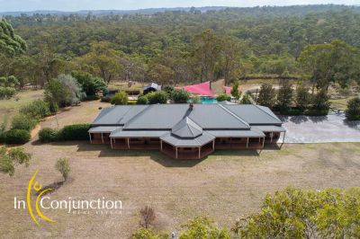 beautiful lifestyle property on 25 acres with magnificent home, resort-style pool, large shed; perfect set-up for the growing family.