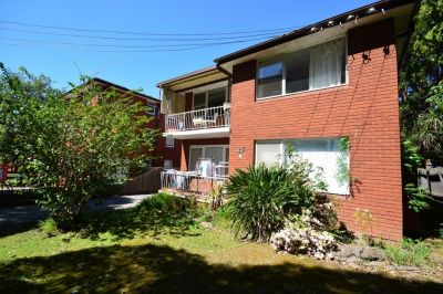 BRIGHT TWO BEDROOM UNIT WITH LOCK UP GARAGE!