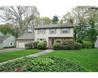 Beautifully renovated Colonial w/great curb appeal on a fabulous landscaped level lot