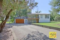 Modernised home on approx. 2.16 acres, excellent side access!