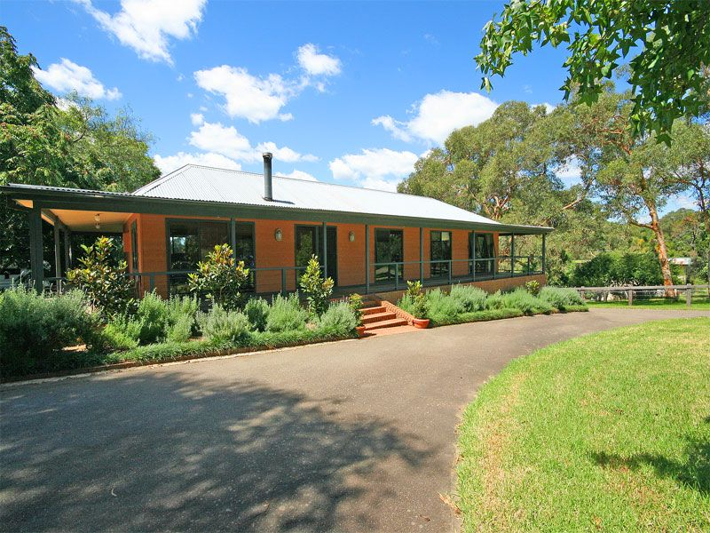Picturesque country home surrounded by fabulous horse paddocks and pretty cottage gardens.