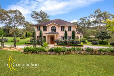 stunning acreage property. elegant five bedroom home privately positioned on park-like acres with mesmerising vistas..