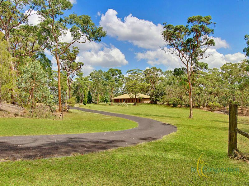 Picturesque rural retreat on large rolling acres suitable for horses, lifestyle. Peaceful with quality home + water glimpses.