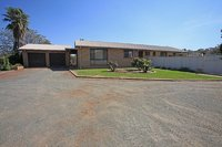Comfortable 4 BR Home with a Large Shed situated on a spacious block