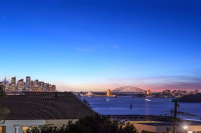 An invitingly spacious dual level family home with iconic harbour views