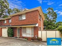 Contemporary Townhouse. 3 Bedrooms. Private Neat Courtyard. 2 Toilets. Lock Up Garage and Car Space. Quiet Location.