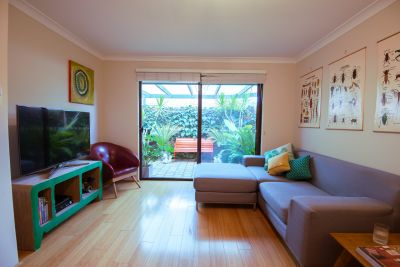 RENOVATED END UNIT WITH GENEROUS OUTDOOR SPACES!