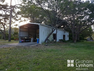 Vacant 1 acre allotment with large shed