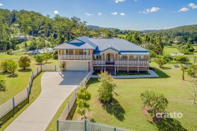 Ideal family home with Hinterland views & Usable Acreage