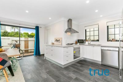 IDEALLY LOCATED TOWNHOUSE