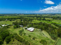 Elevated 6.6 Acres Boasting Two Contemporary Dwellings and Views