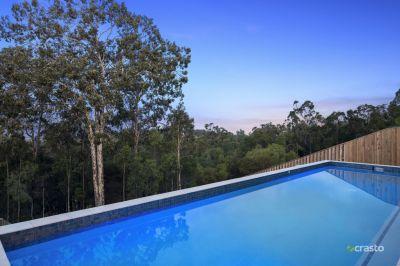 Near New Single-Level Home with Coast & Hinterland Views