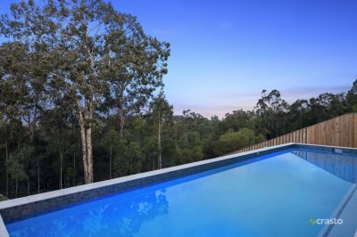 Near New Single-Level Home with Coast & Hinterland Views