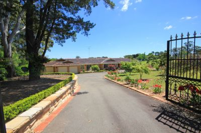 superb park-like acres, picturesque dam, beautiful established gardens and large home, ideal for extended family living.
