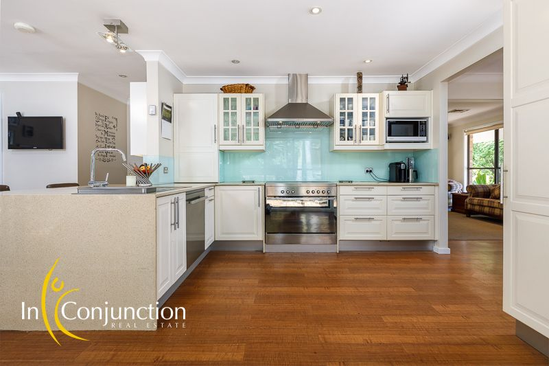 Delightful single level 4 bedroom home plus study on large block with resort-style pool, double garage and work-shed.