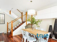 EXCLUSIVE AND CONTEMPORARY THREE BEDROOM TRI-LEVEL TOWNHOUSE