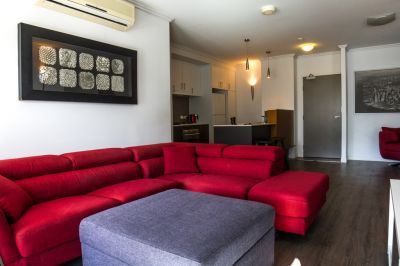Designer Furnished Apartment - Near New + 2 Car Spaces!!