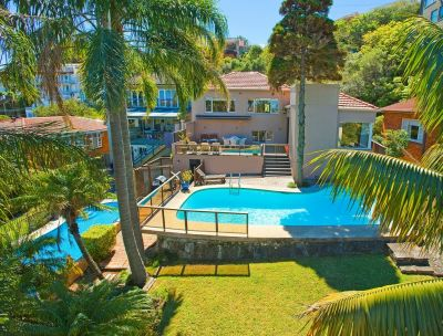 Spectacular Views to Ocean and CBD Skyline From Family Home On Approx 793 sqm Land With Sunny Garden + Pool