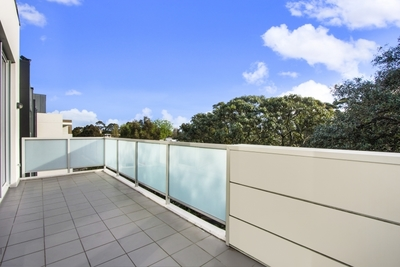 Large, Modern, bathed in Natural Light with Large Balcony!