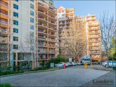 Convenient location, North facing renovated apartment with double parking and district views