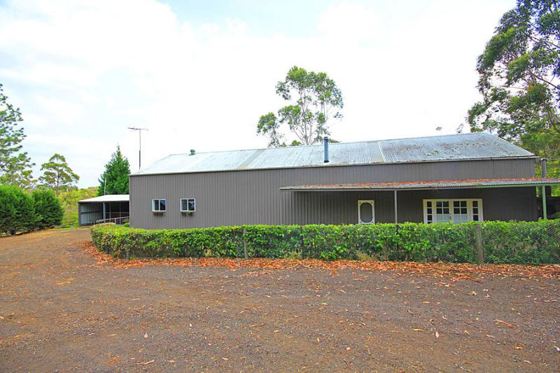 10 stunning acres - ideal equestrian property; post and rail fenced paddocks, massive shed plus charming country home.