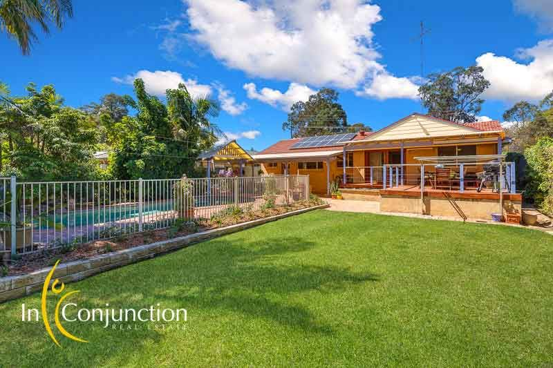 Delightful single level 4 bedroom home on large block with resort-style pool and work-shed.