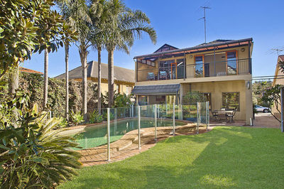 Beach-Side Family Home Complete with Tropical Gardens, Entertaining Deck & Pool.