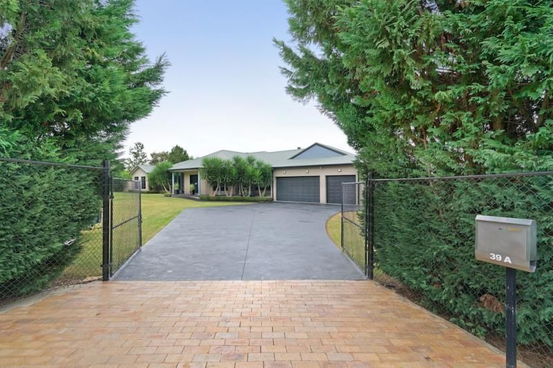 Luxurious master built home on approx. 4 acres!