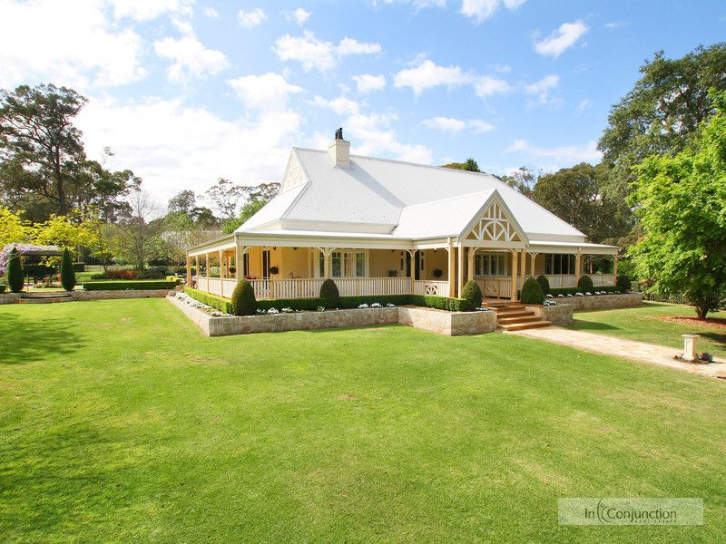 The Southern Highlands comes to Arcadia! Iconic elegant English style country homestead on picture perfect acres with fabulous horse facilites.