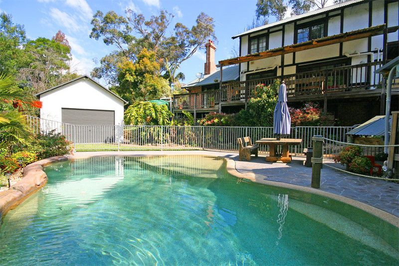 Large family home on quarter acre with bush reserve back drop plus large shed with separate access; ideal for trade-person/home business
