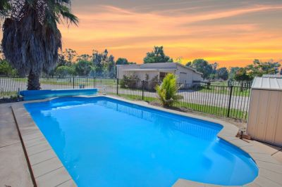HOME + POOL + STABLES + ACREAGE = HAPPY FAMILY
