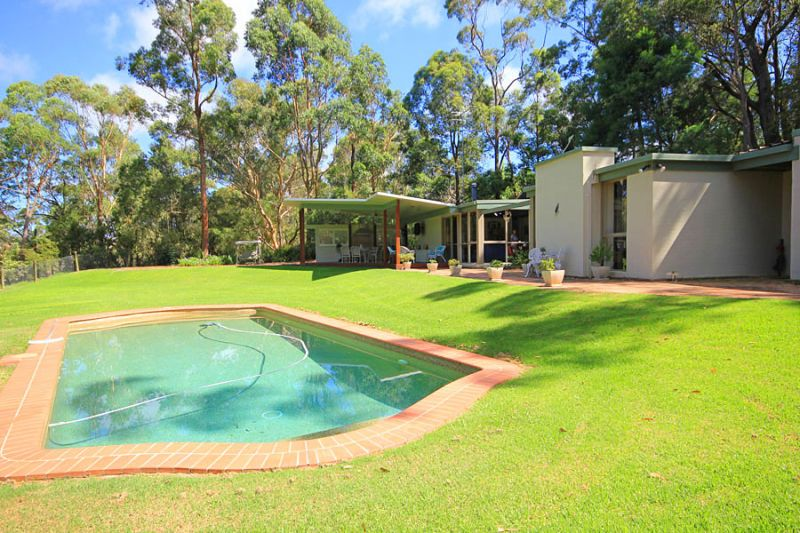 Simply gorgeous! Tranquil haven on low maintenance acres with stunning bush views and complete privacy  a definite wow factor!!!