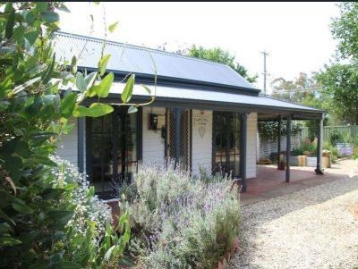 2 PROPERTIES FOR THE PRICE OF 1 - PRETTY MINORS COTTAGE PLUS LAND WITH WORK SHED & OFFICE IN THE HEART OF TOWN