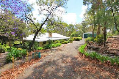 charming country cottage with wrap-around bull-nose verandahs and picturesque cottage gardens on a smaller acreage block.