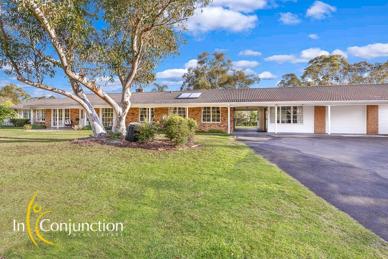 A fantastic family property with pretty single level 4 bedroom home and independent home office on 5 lovely acres with horse facilities.