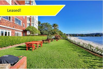 Charming 2 Bedroom Apartment at the Rear of a Waterfront Block with Private Green Outlook